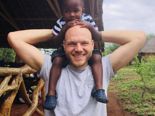 Kiano with his father, Matt, on safari