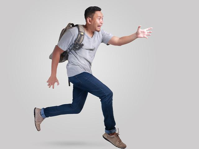 afraid student running