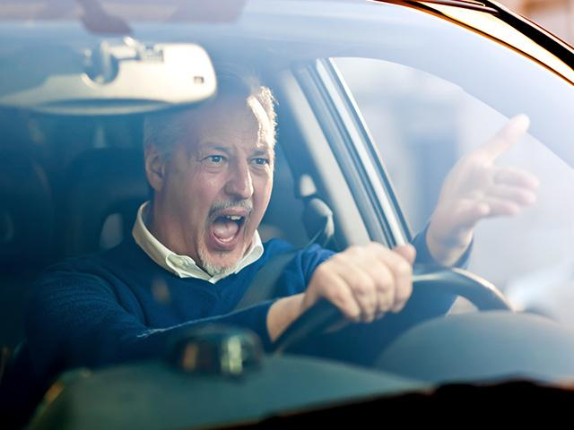 man in car angry with other driver