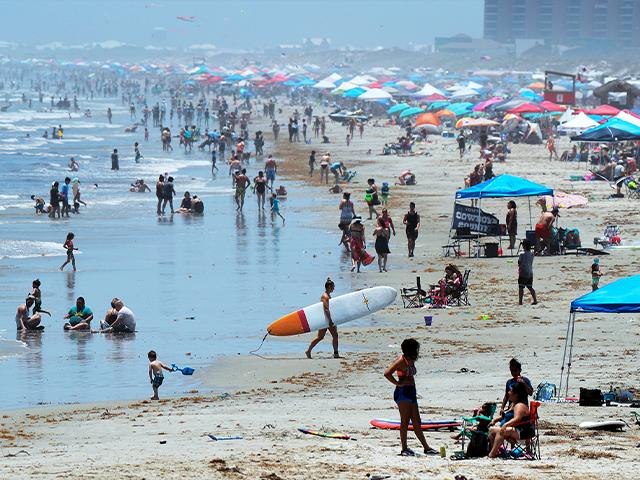 People gather on the beach for the Memorial Day weekend in Port Aransas, Texas, Saturday, May 23, 2020. Beachgoers are being urged to practice social distancing to guard against COVID-19. (AP Photo/Eric Gay)