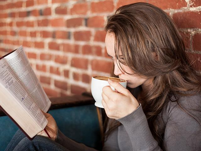 woman sipping coffee and reading a Bible