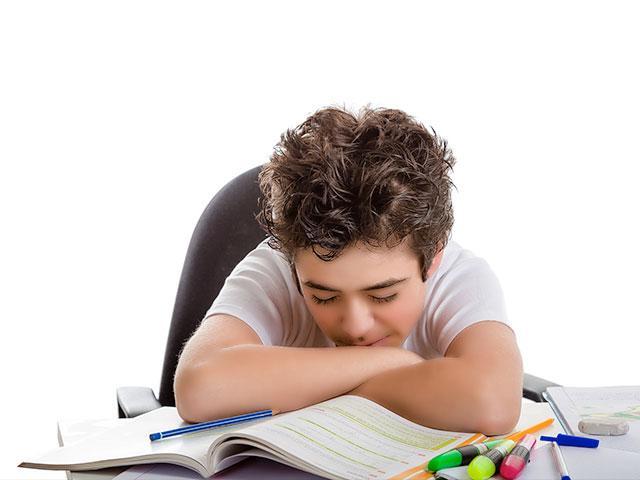 Boy tired at school