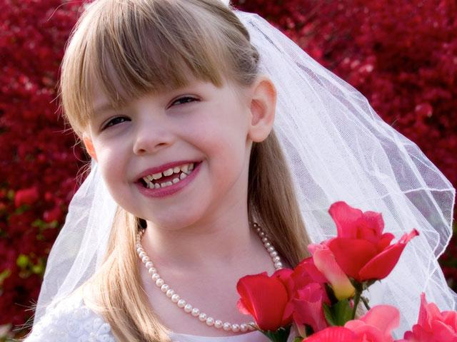 little girl dressed up as a bride