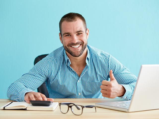 businessman smiling thumbs up