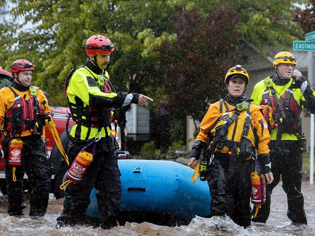 Santa Rosa firefighters check for residents trapped by floodwaters on Neotomas Avenue in Santa Rosa, Calif., on Sunday, Oct. 24, 2021. (AP Photo/Ethan Swope)