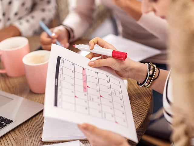 women with planning calendars