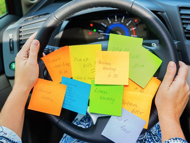 to do list sticky notes on car steering wheel