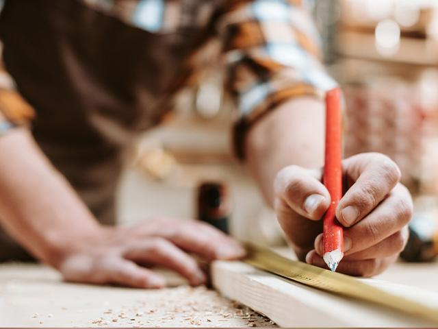 carpenter making measuring marks with a pencil