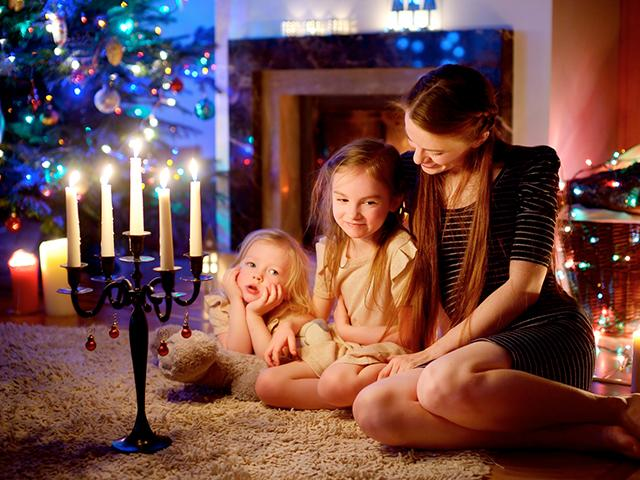 mother and children at Christmas with candles