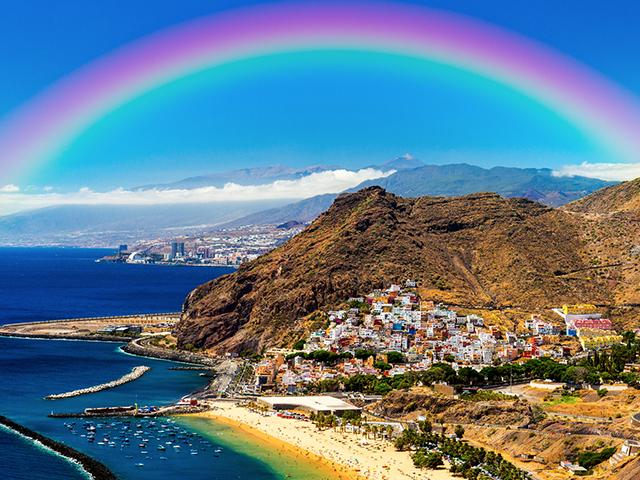 rainbow over a mountain coast