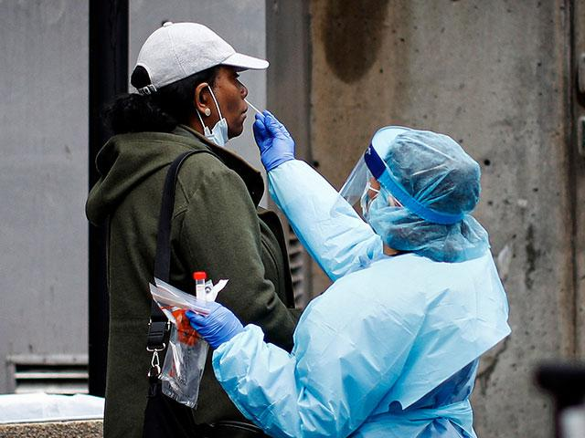 A patient is given a COVID-19 test by a medical worker outside Brooklyn Hospital Center (AP Photo)
