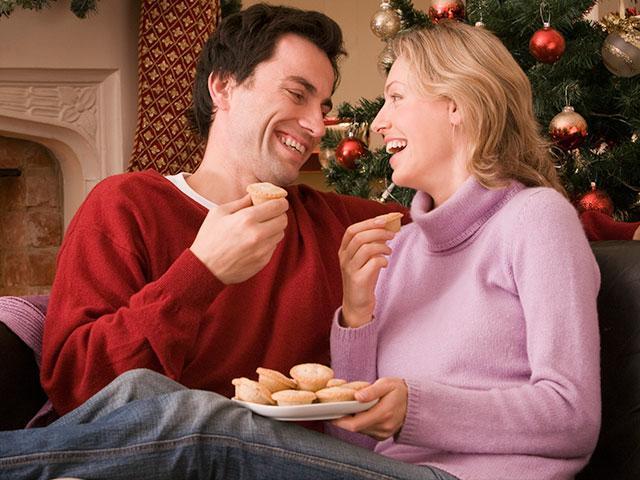 Couple eating Christmas cookies