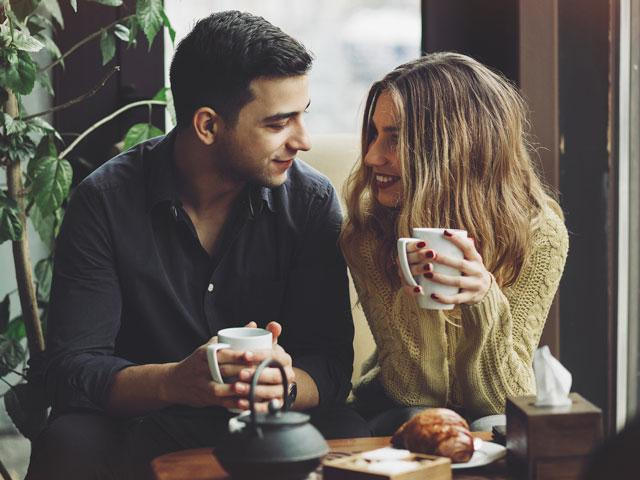Dating couple drinking coffee