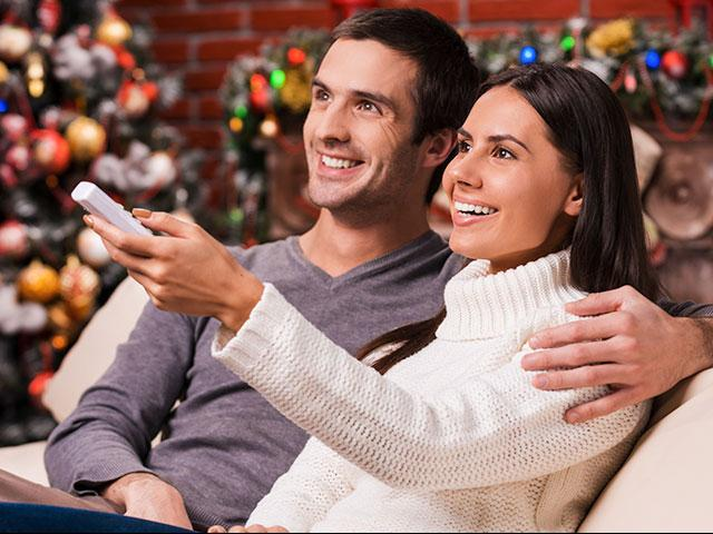 Couple watching a Christmas movie