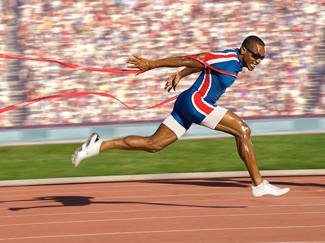 man crossing the finish line
