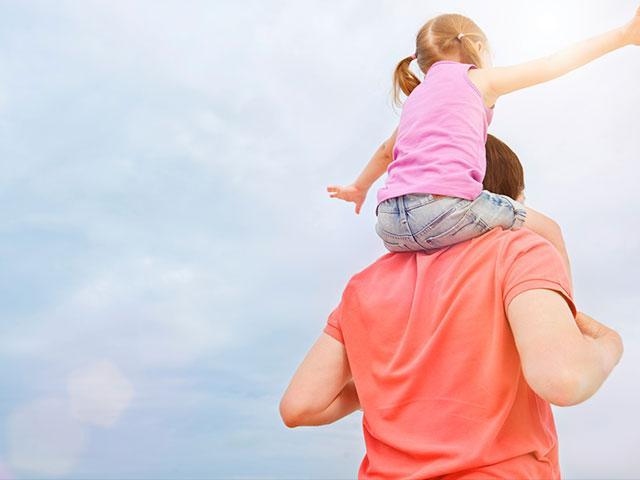 Dad carrying daughter