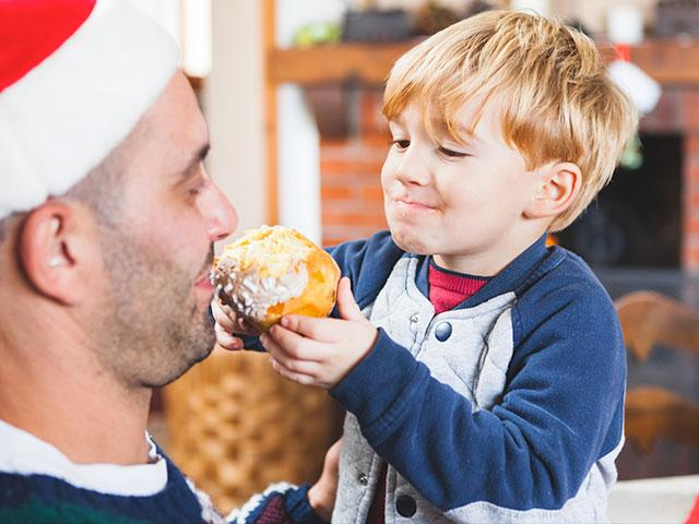 Dad eating cake at Christmas
