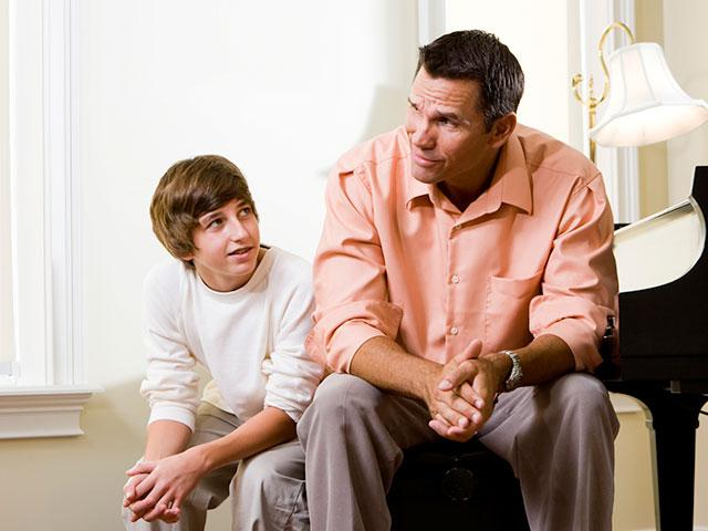 Dad and son in serious talk