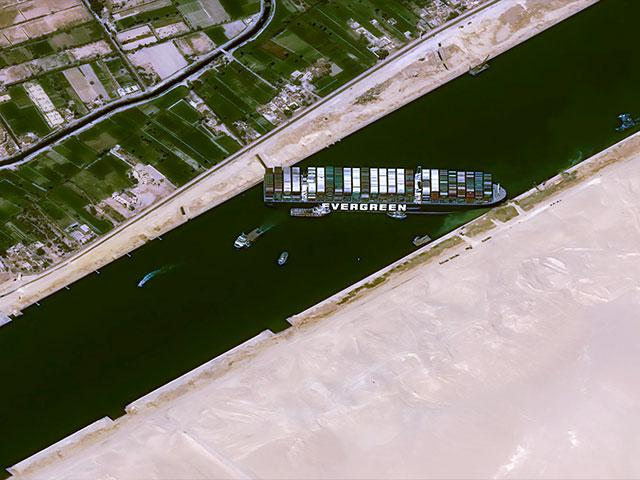 This satellite iamges shows the cargo ship MV Ever Given stuck in the Suez Canal near Suez, Egypt, Thursday, March 25, 2021. (Cnes2021, Distribution Airbus DS via AP)