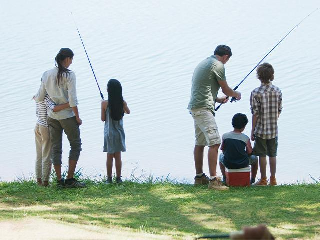 family fishing at a lake