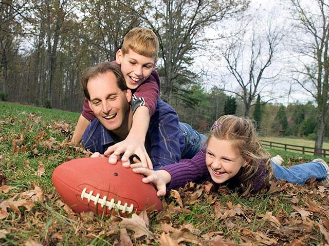 Family traditions at Thanksgiving, playing football