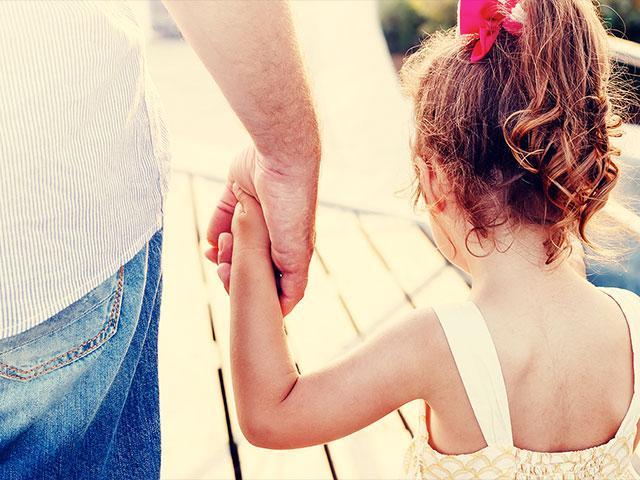 fatherdaughterholdhandsas