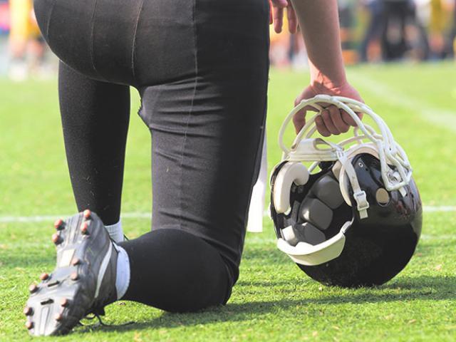 football player kneeling