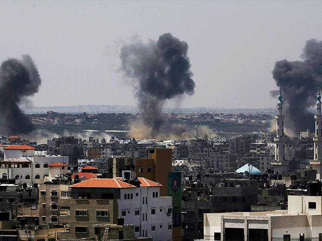 In this July 16, 2014 file photo, smoke rises after Israeli missile strikes hit the northern Gaza Strip. (AP Photo/Adel Hana, File)