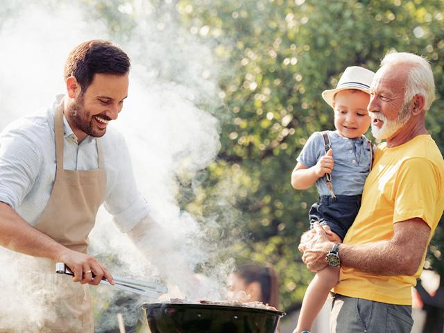 three generations men grilling