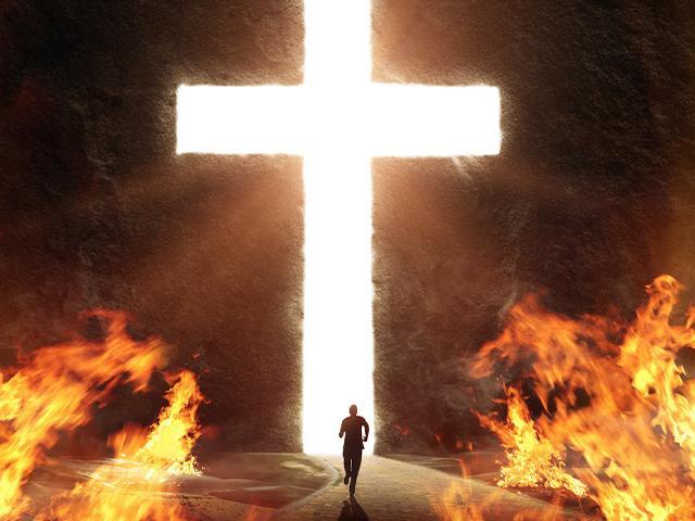 person running away from flames toward giant bright white cross shaped opening