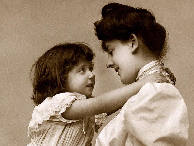 girl-hugging-mother-antique