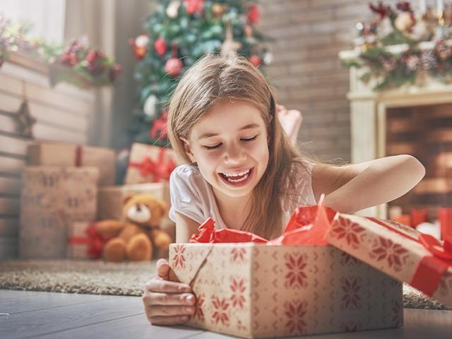happy girl opening christmas present