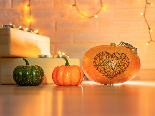 autumn decor with pumpkin and lights