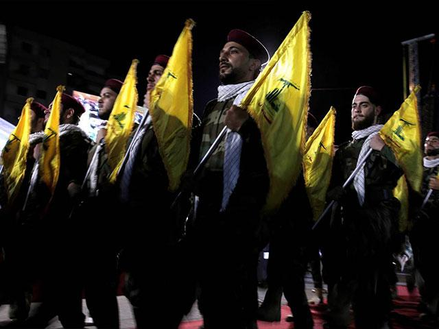In this May 31, 2019 file photo, Hezbollah fighters march at a rally.  (AP Photo/Hassan Ammar, File)