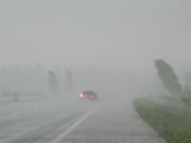rain and wind blur car on highway