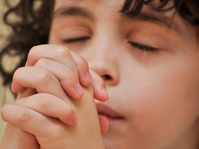 hispanic-boy-praying_SI.jpg