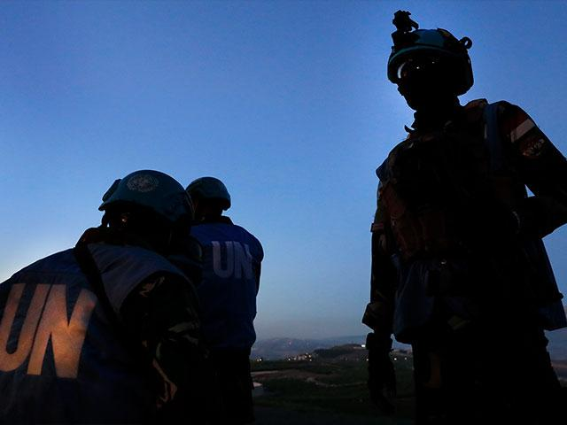 Indonesian U.N peacekeepers stand guard at the Lebanese side of the Lebanese-Israeli border in the southern village of Kfar Kila, Lebanon, Saturday, May 15, 2021. Israel warned Lebanese authorities not to allow protesters to breach the border. (AP Photo/