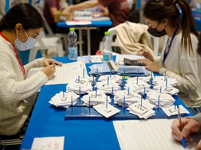 Workers count votes in Israel's national elections, at the Knesset in Jerusalem, Thursday, March 25, 2021. (AP Photo/Maya Alleruzzo)