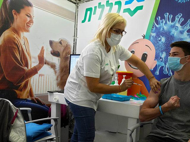 An Israeli youth receives a Pfizer-BioNTech COVID-19 vaccine in the Israeli city of Holon near Tel Aviv, Monday, Feb. 15, 2021. (AP Photo/Sebastian Scheiner)