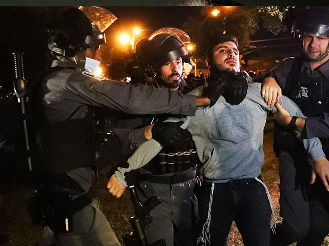 Israeli border police detain an Israeli youth as members of a Jewish extremist group try approach to Damascus Gate to protest amid heightened tensions in Jerusalem. Thursday, April. 22, 2021. (AP Photo/Ariel Schalit)