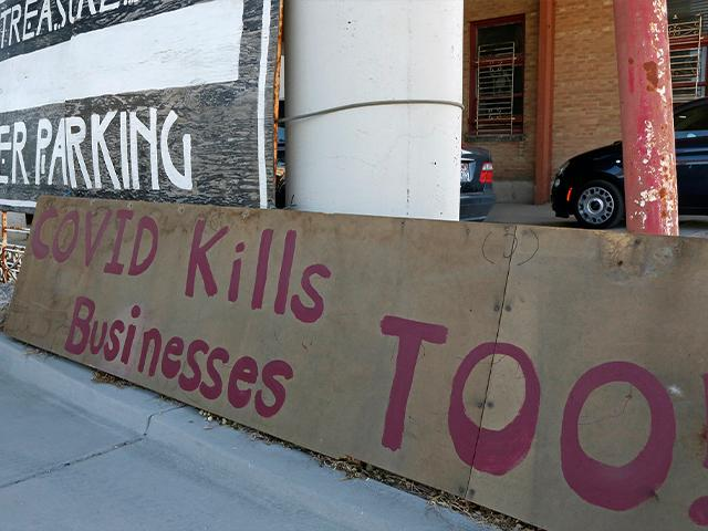 "A ""Covid kills businesses too"" sign is shown outside Euro Treasures Antiques, May 8, 2020, in Salt Lake City. (AP Photo/Rick Bowmer)"