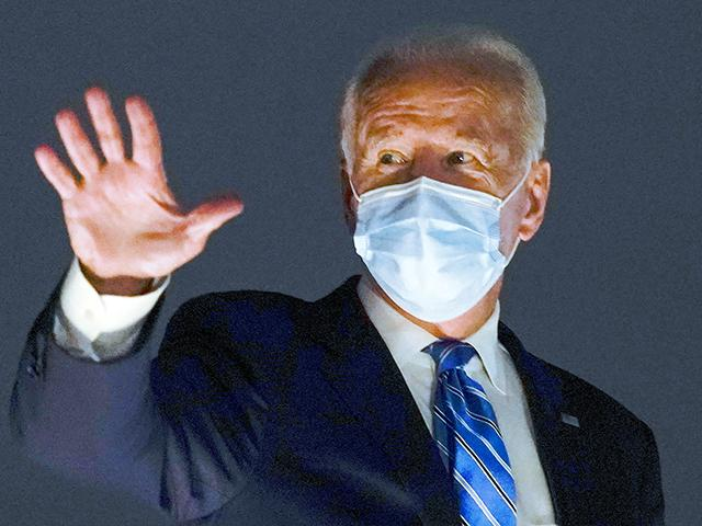 Democratic presidential candidate former Vice President Joe Biden boards his campaign plane at Miami International Airport in Miami, Monday, Oct. 5, 2020, to travel home to Wilmington, Del. (AP Photo/Andrew Harnik)