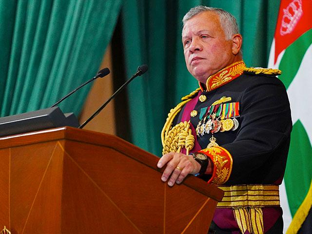 In this Dec. 10, 2020 photo released by the Royal Hashemite Court, Jordan's King Abdullah II gives a speech.