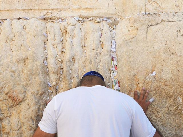 Prayer notes removed from Western Wall. Photo: CBN News/Jonathan Goff