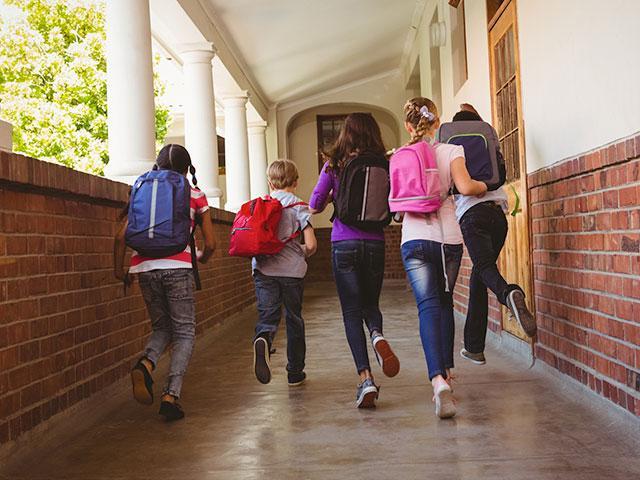 Kids running down school hallways
