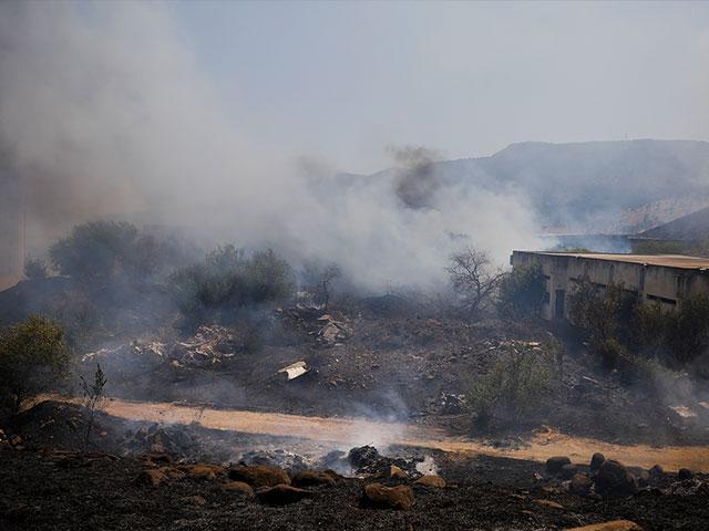 Fields burn following a hit by a rocket fired from Lebanon into Israeli territory, near the northern Israeli town of Kiryat Shmona, Wednesday, Aug. 4, 2021. (AP Photo/Ariel Schalit)