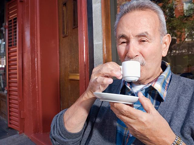 older man drinking espresso