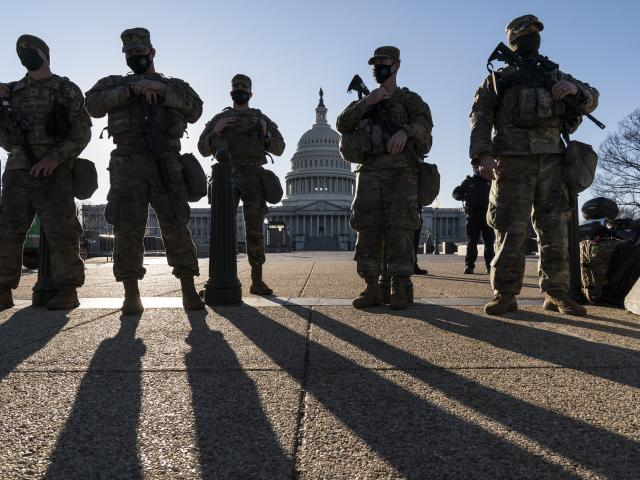 Members of the Michigan National Guard and the U.S. Capitol Police keep watch