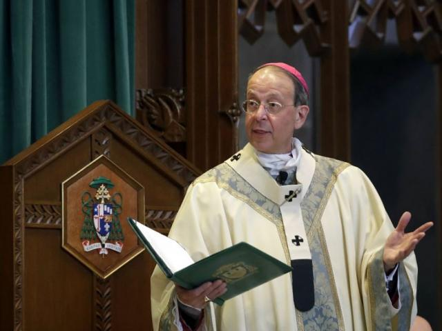 In this March 28, 2017, file photo, Baltimore Archbishop William Lori leads a funeral Mass in Baltimore. (AP Photo/Patrick Semansky, File)