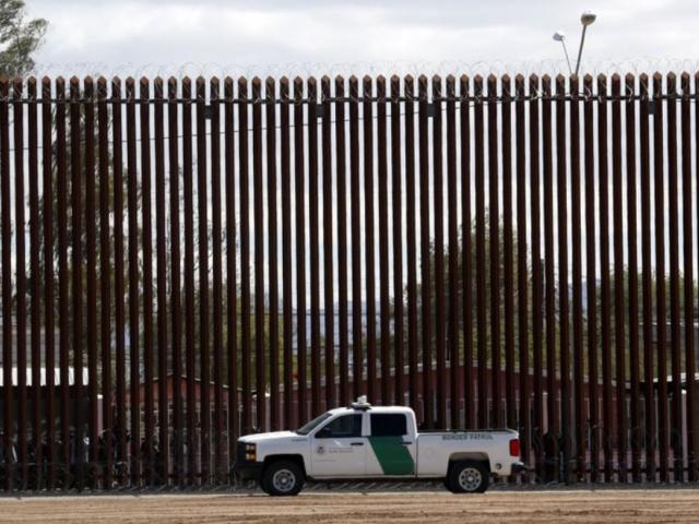 In this April 5, 2019, file photo, a U.S. Customs and Border Protection vehicle sits near the wall as President Donald Trump visits a new section of the border wall with Mexico in El Centro, Calif.  (AP Photo/Jacquelyn Martin, File)